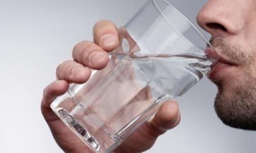 Лекарство принимают пероральным способом (внутрь) и запивают жидкостью