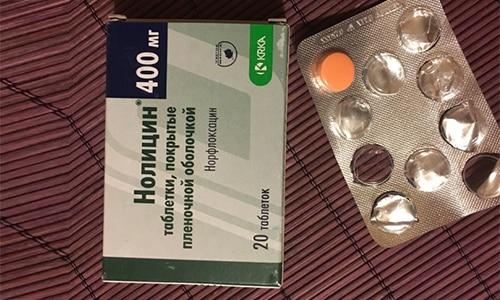 Производится препарарт в виде таблеток, которые имеют оранжевый оттенок
